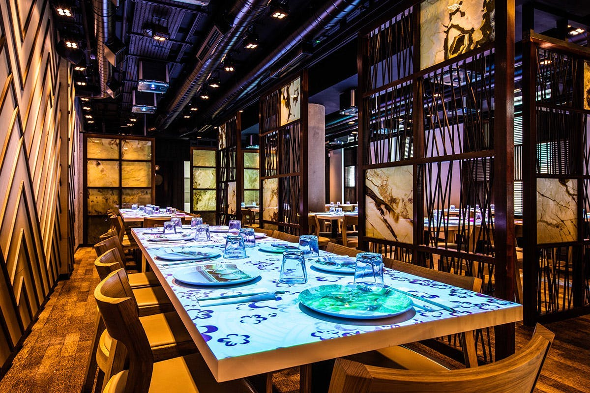 Table with plates and interactive tablets