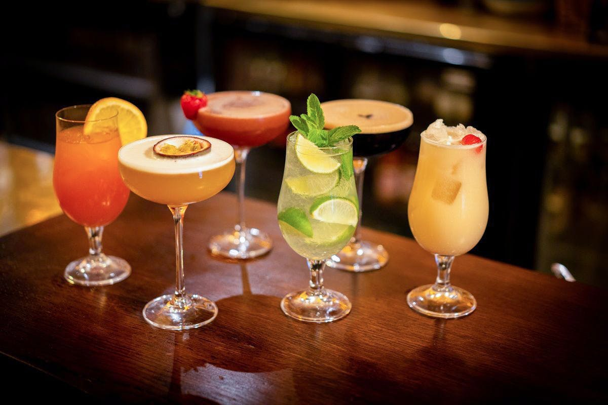Picture of six different cocktails on a table