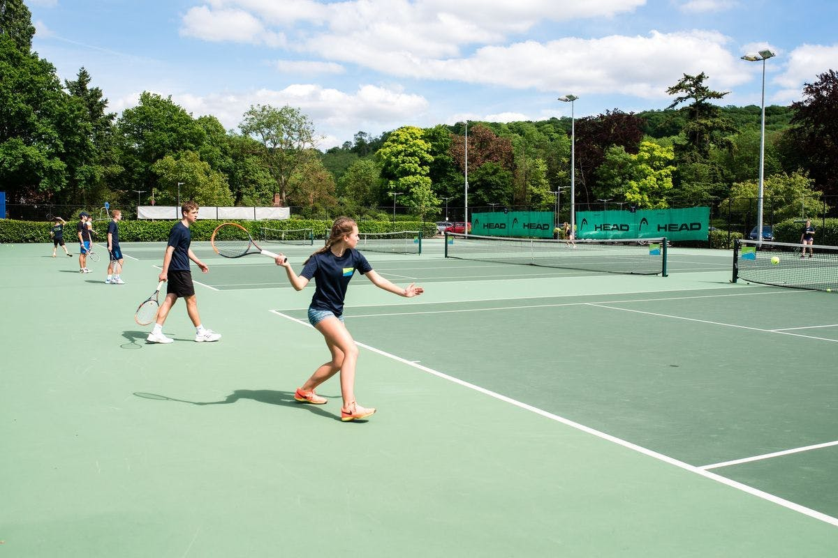 Image of people playing tennis at Bisham Abbey outdoor tennis courts