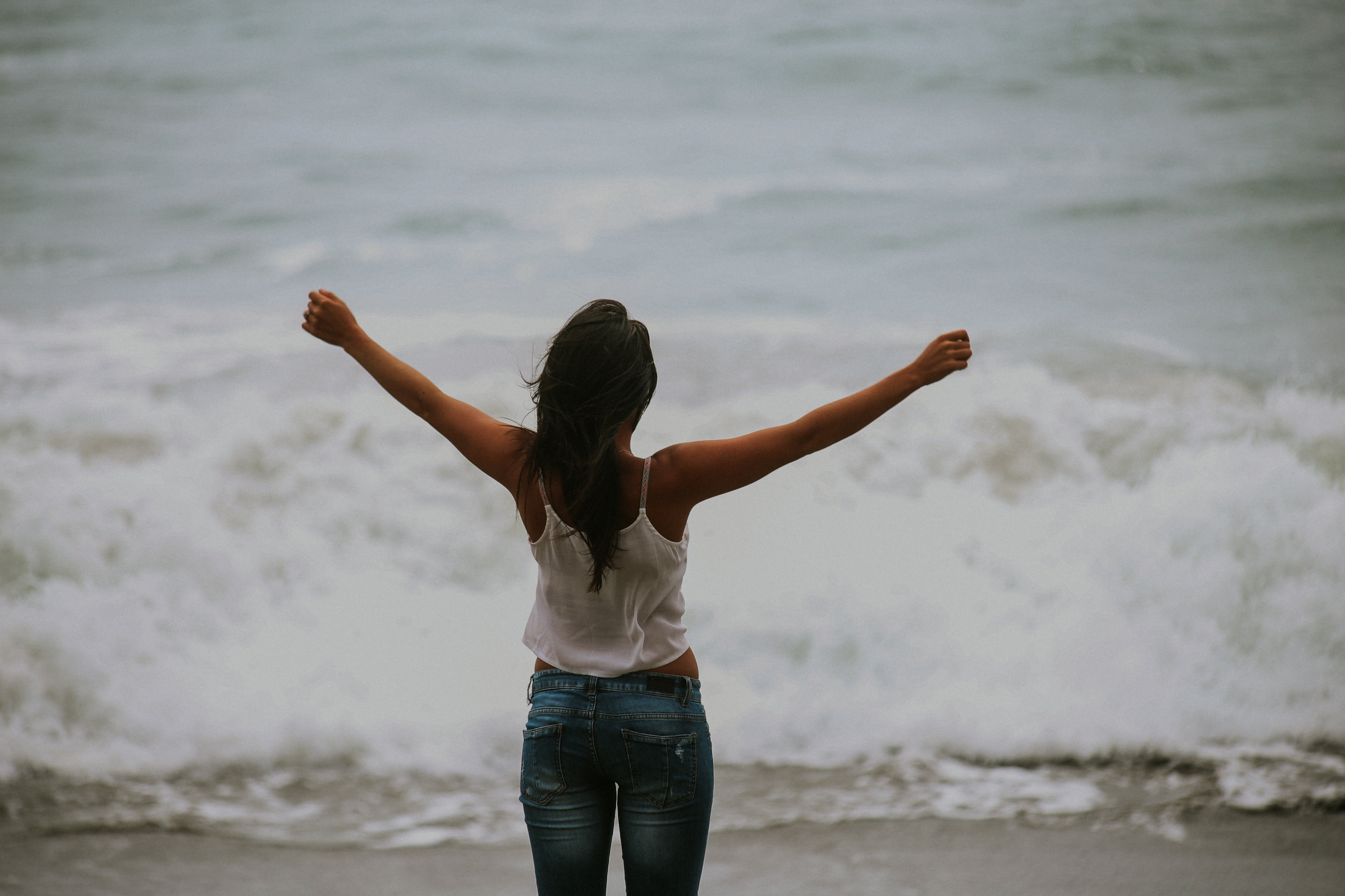 Woman triumphantly holding up arms