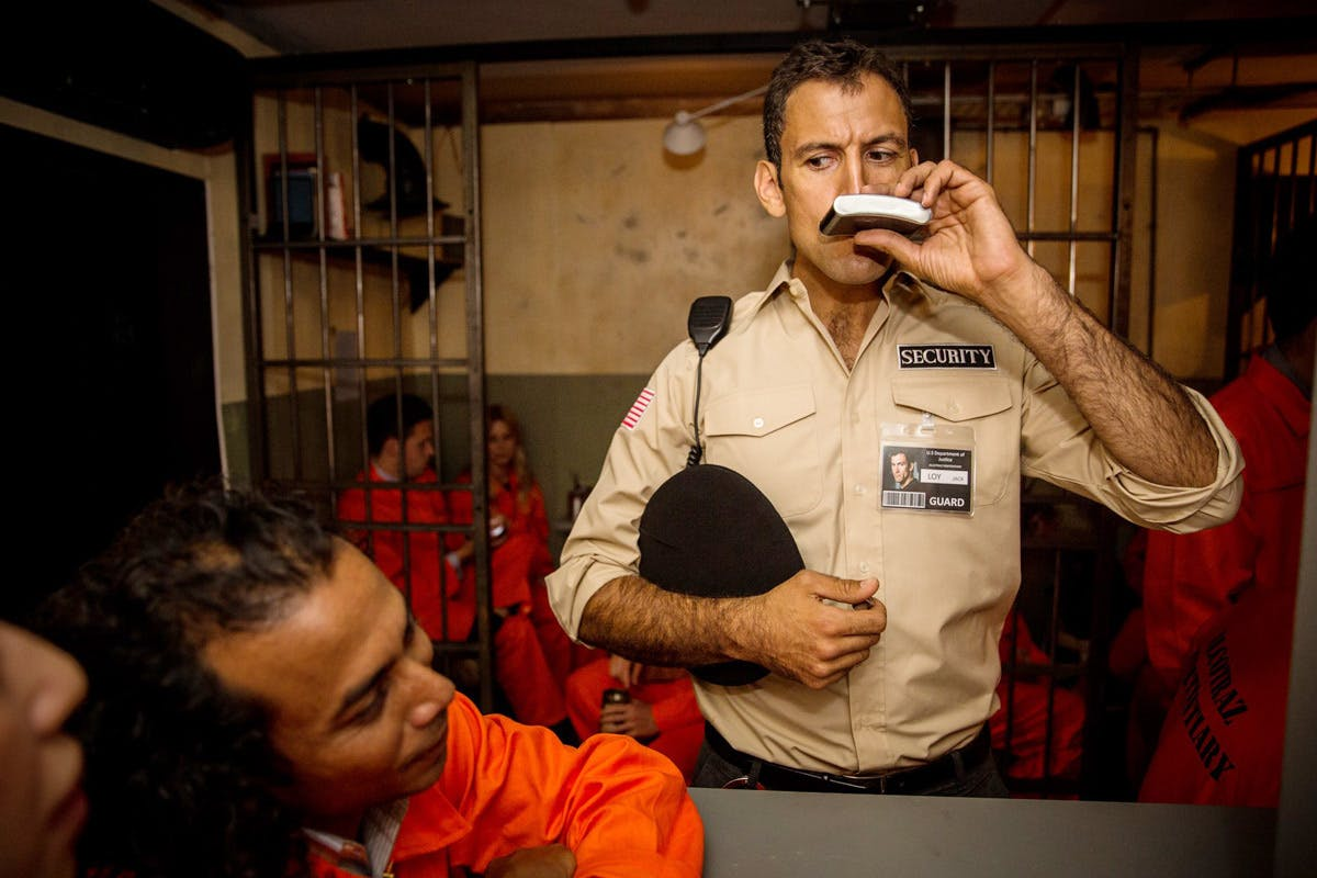 Bespoke cocktails at London's first prison themed cocktail bar with security guards and inmates
