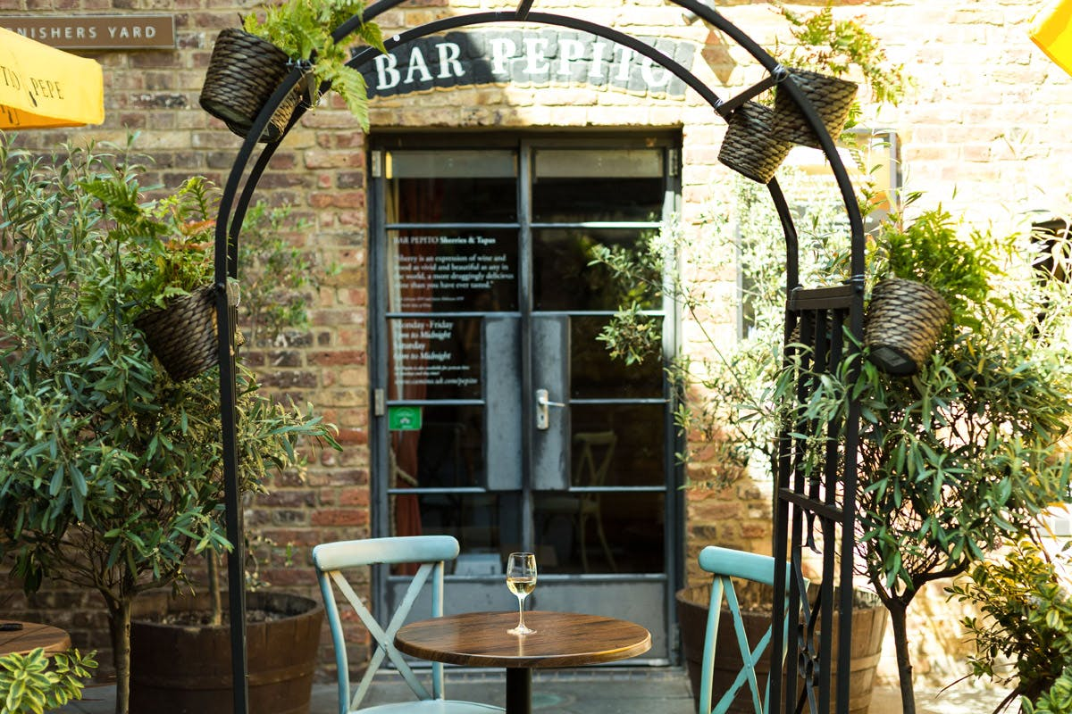 Sharing Tapas with Cava for Two at Rustic Spanish Bar Pepito