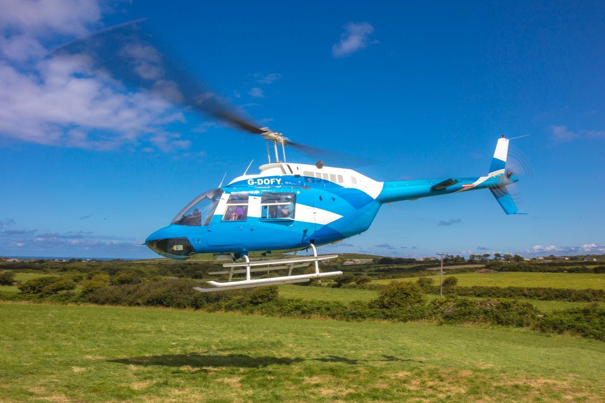 Summer Discovery Day with Helicopter Trip and Guided Hike for Two